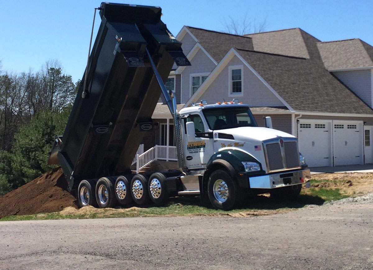 camion Haul hauling Zemba-Bros-Trucking-Hauling-Materials-Sand-Top-Soil-Rock-Stone-Dirt